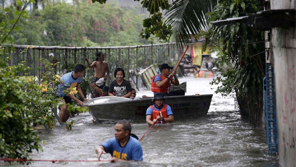 "Taifun ""Usagi"": Kampf gegen die Wassermassen"
