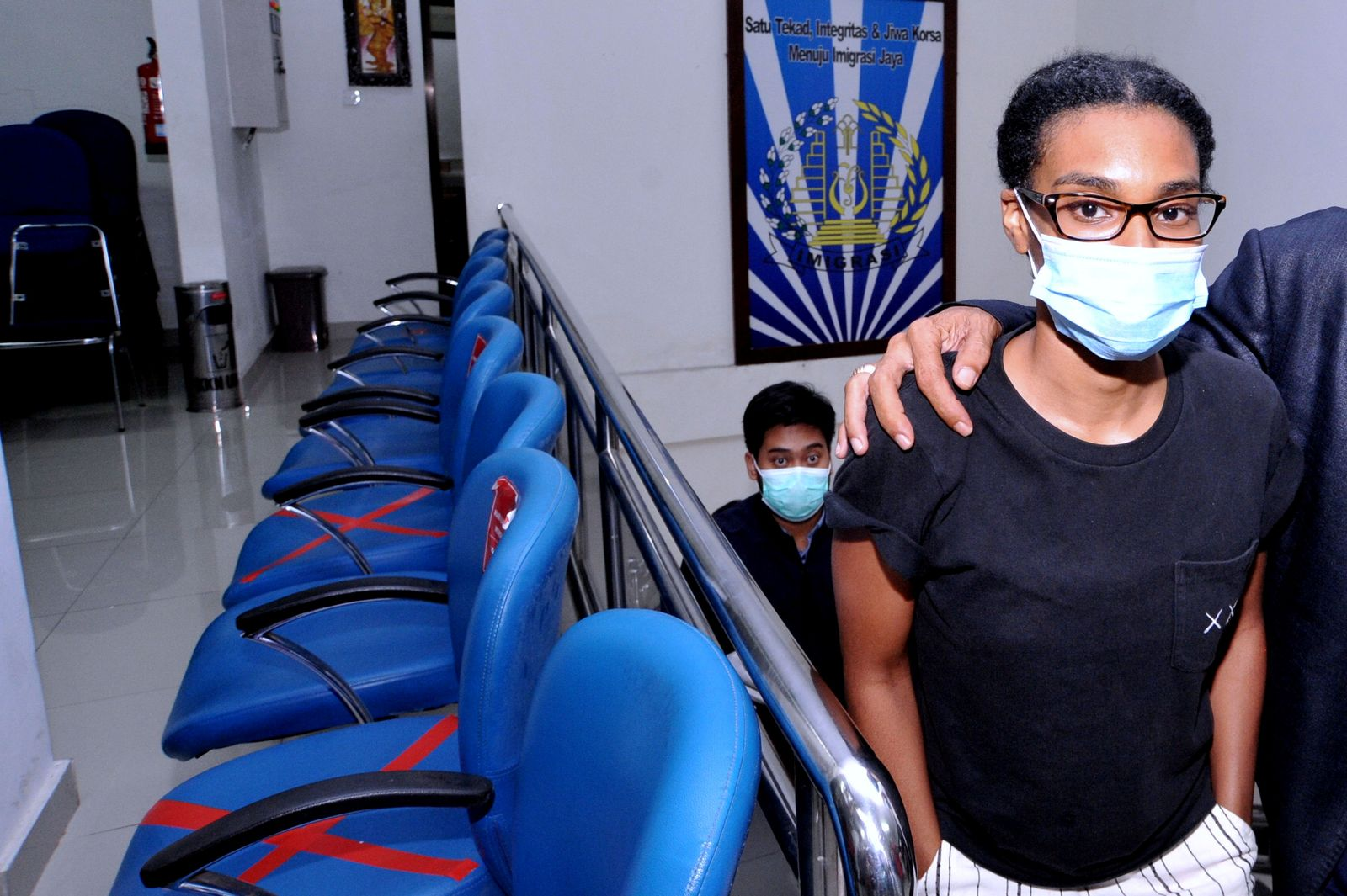 An American woman and self-described digital nomad Kristen Gray looks on after being examined at Indonesian Immigration office in Denpasar