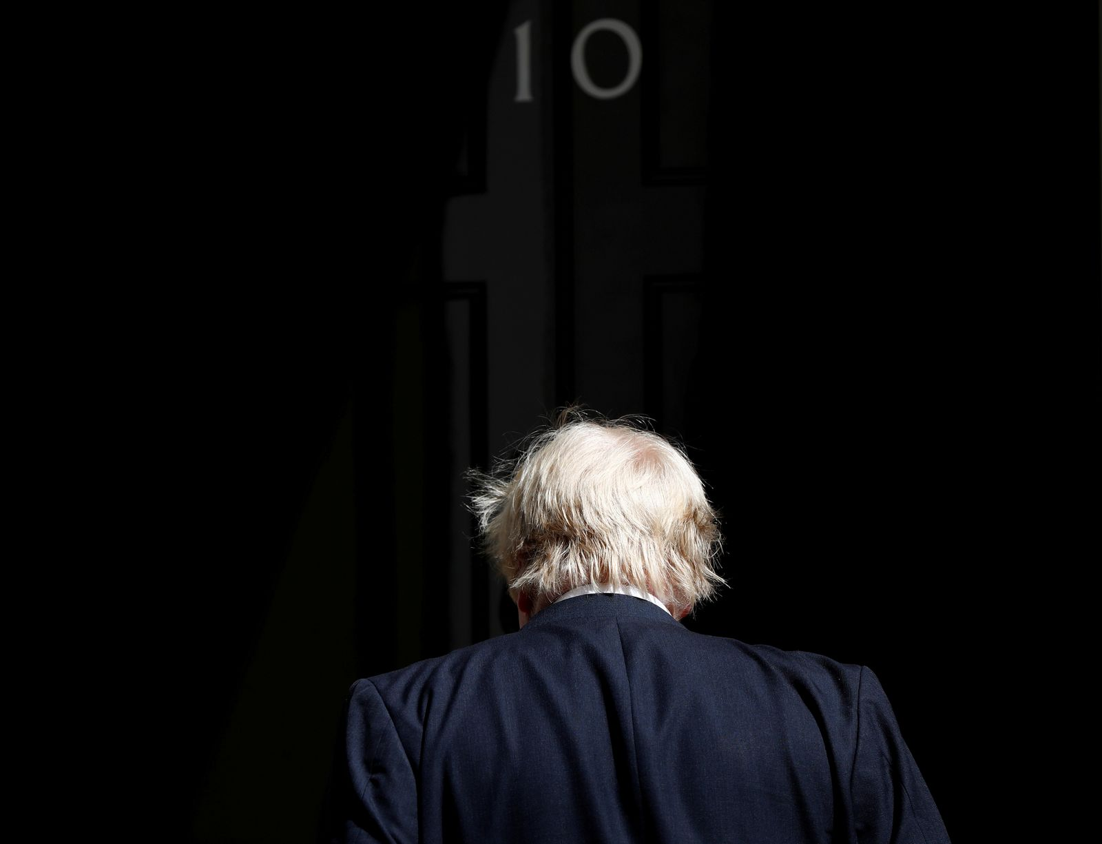 FILE PHOTO: Boris Johnson, Britain's Foreign Secretary, arrives at 10 Downing Street, in central London