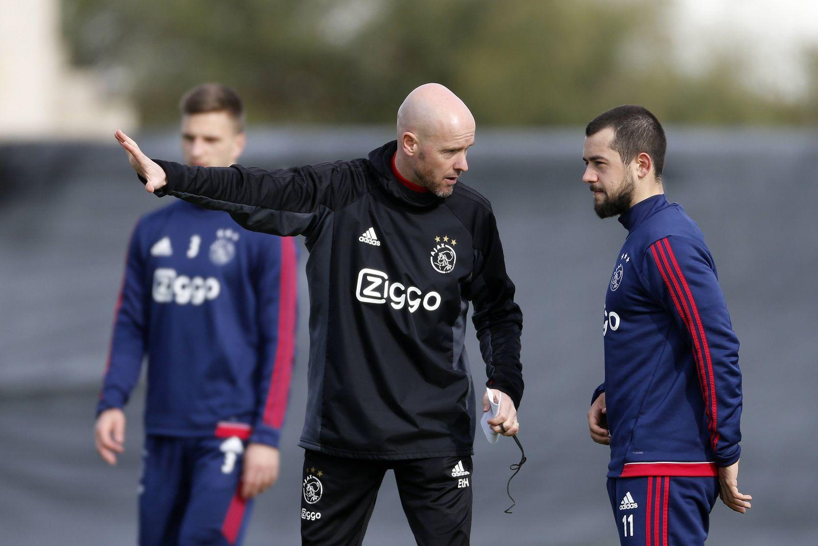L R Coach Erik ten Hag of Ajax Amin Younes of Ajax during a training session of Ajax Amsterdam a