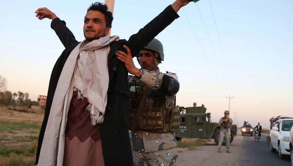 Afghanische Sicherheitskräfte (hier bei Kontrollen): Was wird aus ihnen, wenn immer mehr US-Soldaten abgezogen werden?