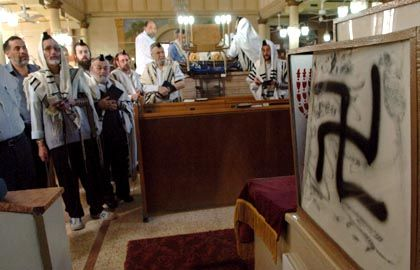 Nazi graffiti sprayed inside the Grand Synagogue in the Israeli town of Petah Tikva, near Tel Aviv, put Israeli police on the trail of the gang last year.
