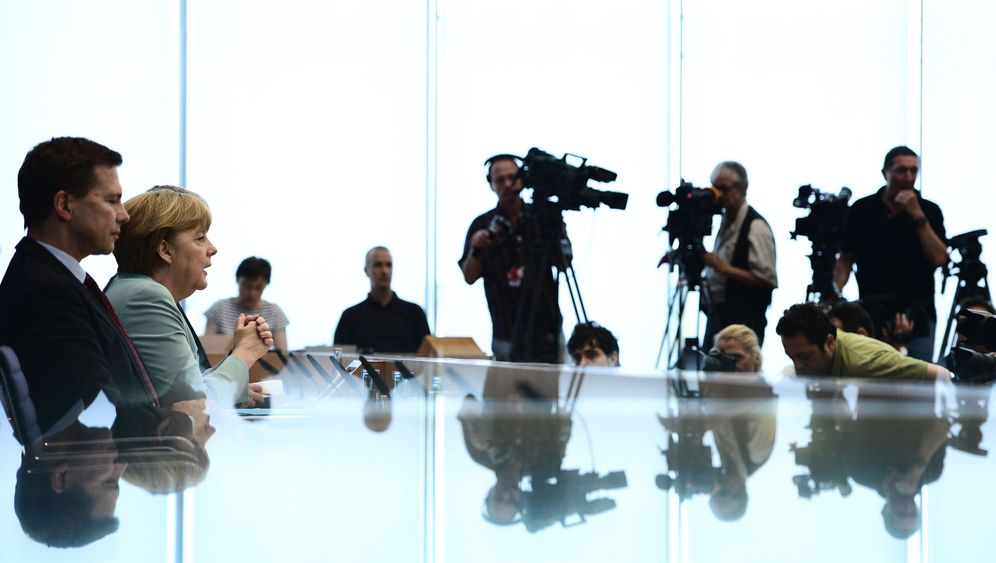 Photo Gallery: Merkel's NSA Problem