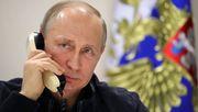 Merkel fordert von Putin Truppenabbau