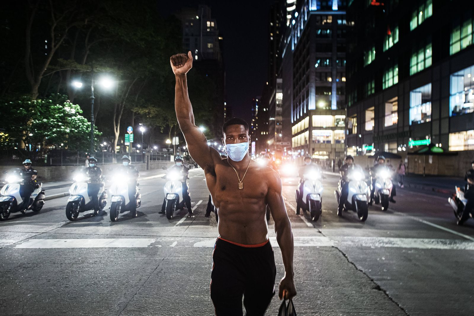 200604 Demonstrator Jakarri Vanderbilt from Louisiana walks with a clenched fist in front of police during a protest ove