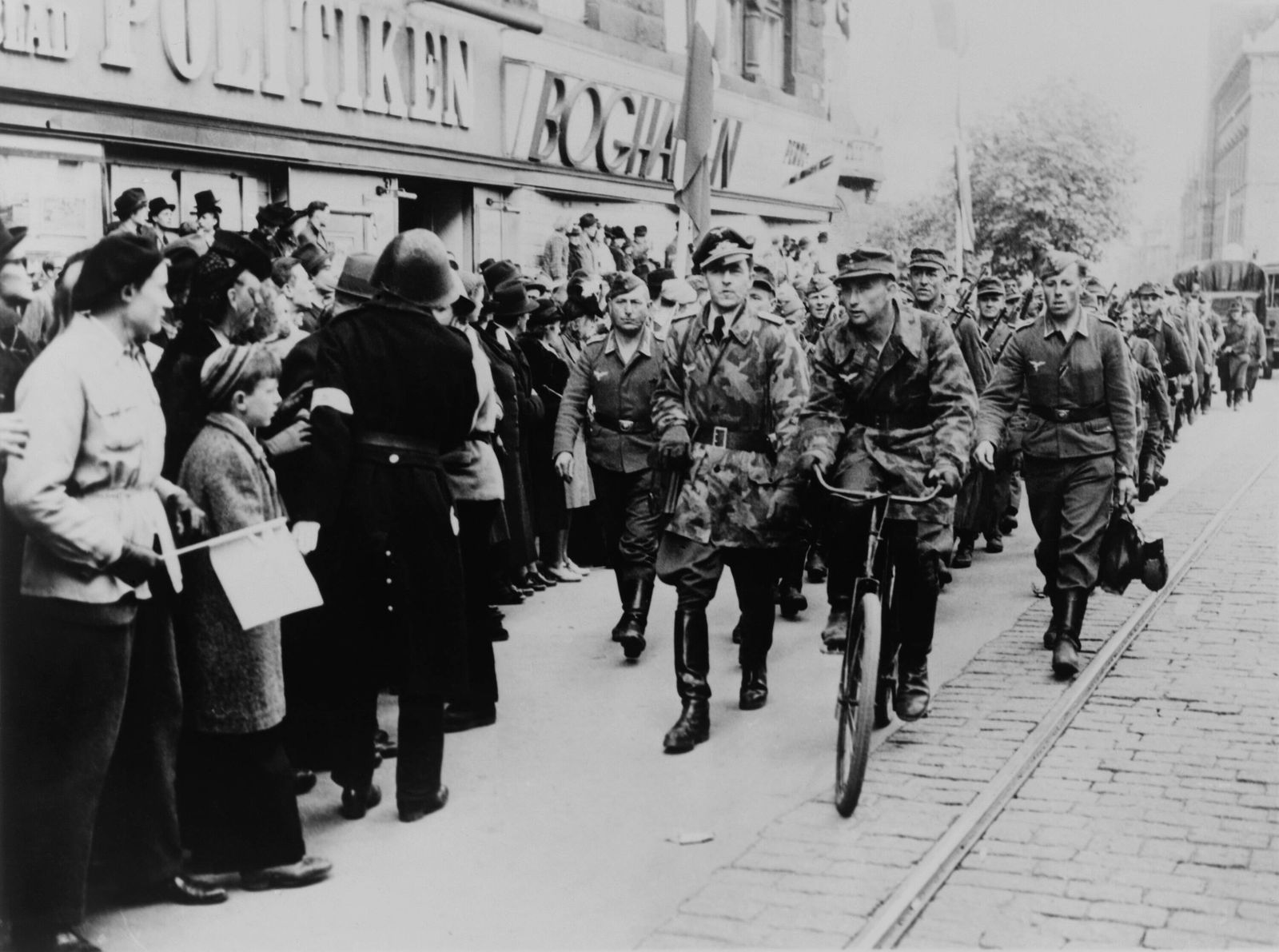 Nazi soldiers march down a commercial street in German-occupied Denmark in 1945. Denmark was one of the last occupied co