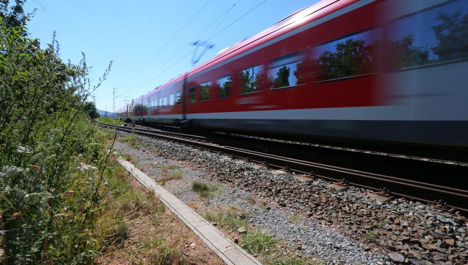 A regional train passes the site near Würzburg, Germany, of an attack Monday that may have been motivated by Islamist hate.