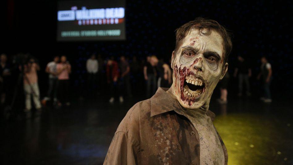 """Joe Giles spielt in """"The Walking Dead"""" einen Zombie. Auch in der Wirtschaftswelt kursieren derzeit verschiedene """"untote"""" Ideen, deren Umsetzung riskant wäre."""