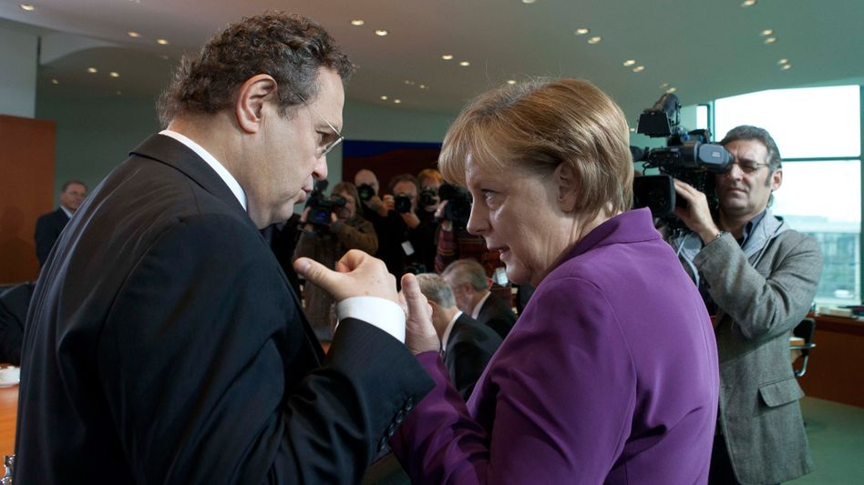 German Chancellor Angela Merkel and Interior Minister Hans-Peter Friedrich in November.