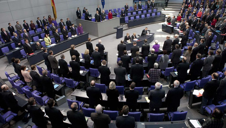 Deputies observe a minute of silence during a session of the Bundestag on Tuesday.