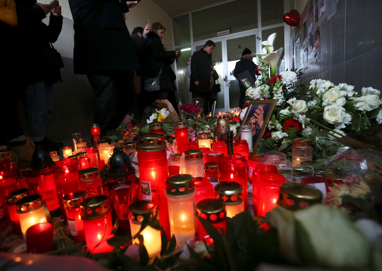 Candles and flowers for the victims of a recent shooting are placed outside a crime scene in Hanau