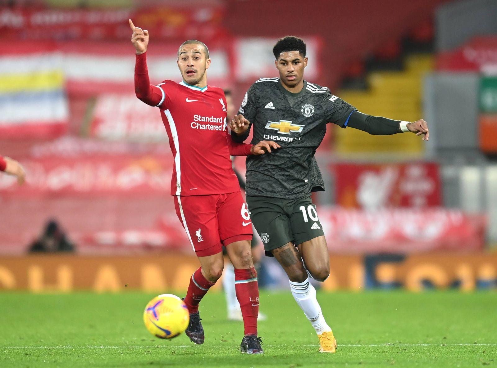 Liverpool v Manchester United, ManU - Premier League - Anfield Liverpool s Thiago Alcantara (left) and Manchester Unite