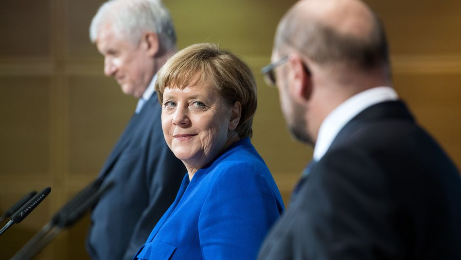 German Chancellor Angela Merkel together with CSU head Horst Seehofer (l.) and SPD head Martin Schulz in Berlin