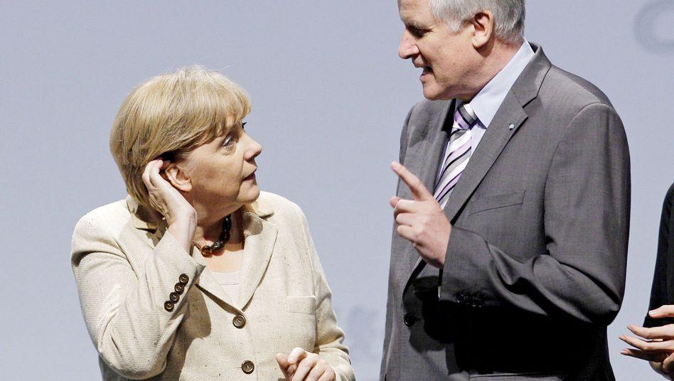 Kanzlerin Merkel, Ministerpräsident Seehofer: Spitzenrunde ohne Spitzenergebnisse