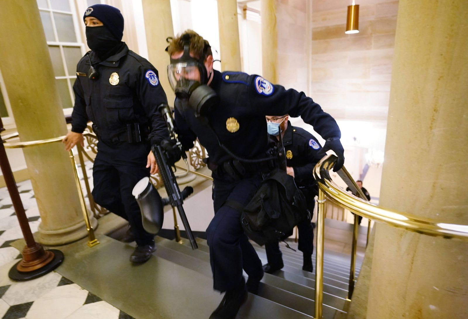 U.S. Capitol police officers take positions as protestors enter the Capitol building during a joint session of Congress