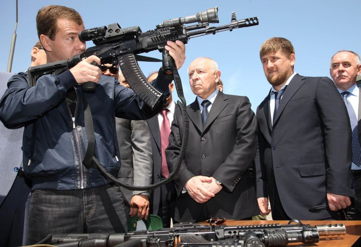 Russian President Dmitry Medvedev sights an automatic weapon at a special forces training center while visiting the provincial capital Makhachkala, Dagestan, in June, with Chechnyan regional President Ramzan Kadyrov (second from right).