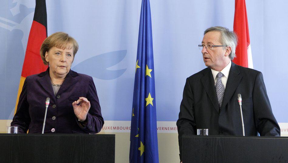 Kanzlerin Merkel und Euro-Gruppen-Chef Juncker: Deutschland mit Milliarden-Bürgschaft