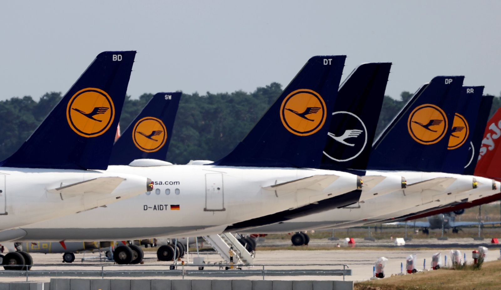 FILE PHOTO: Airplanes of German carrier Lufthansa are parked at the Berlin Schoenefeld airport in Schoenefeld