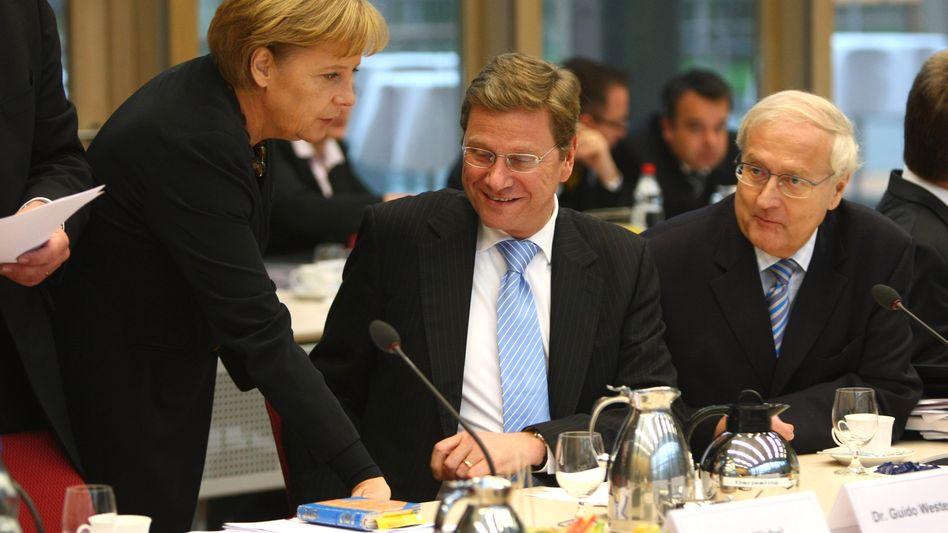 Kanzlerin Merkel, FDP-Prominente Westerwelle, Brüderle: Großkonzerne notfalls zerschlagen