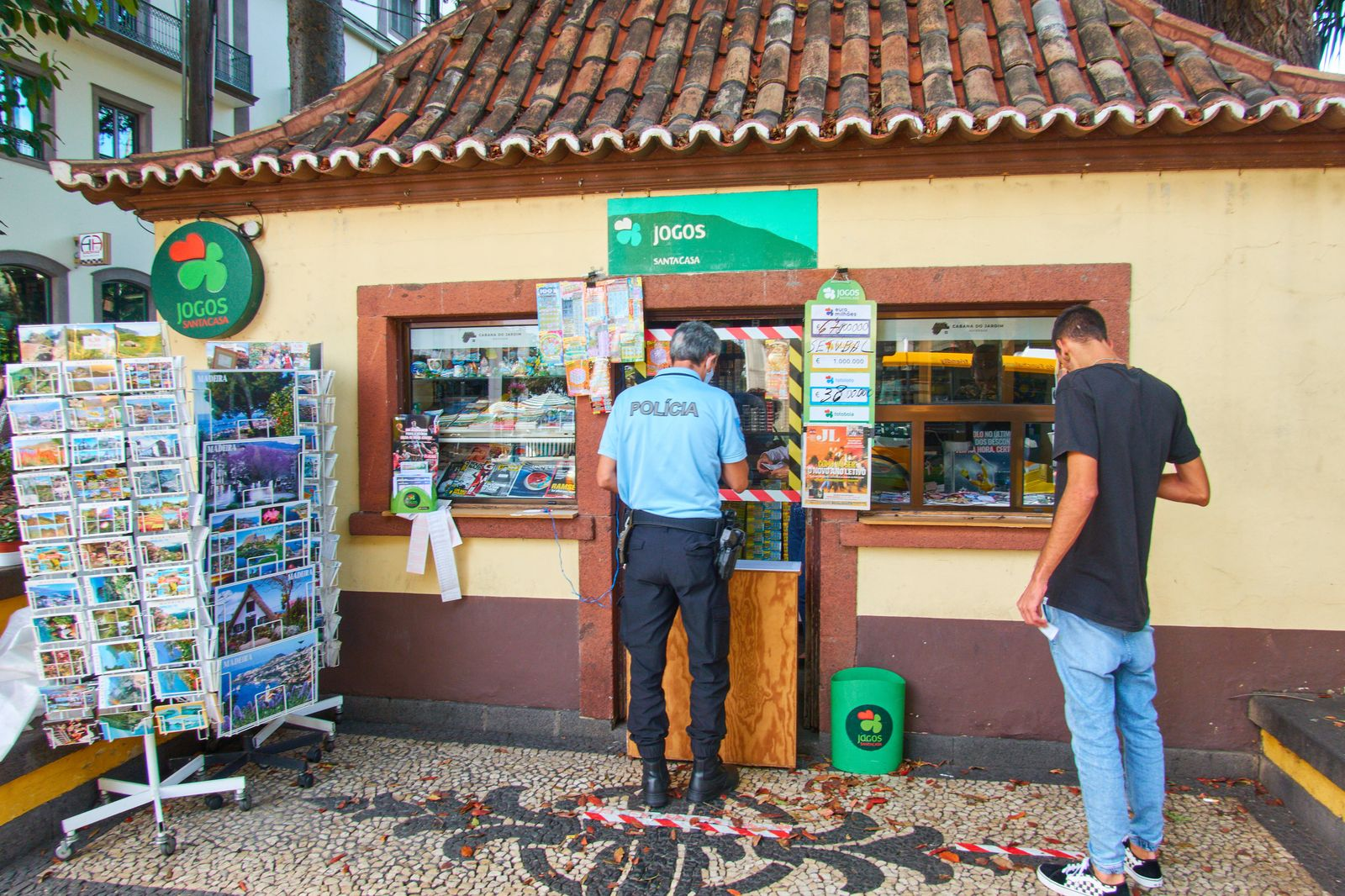 Funchal, Madeira, Portugal, 19th September, 2020. A police man is buying something at a small kiosk