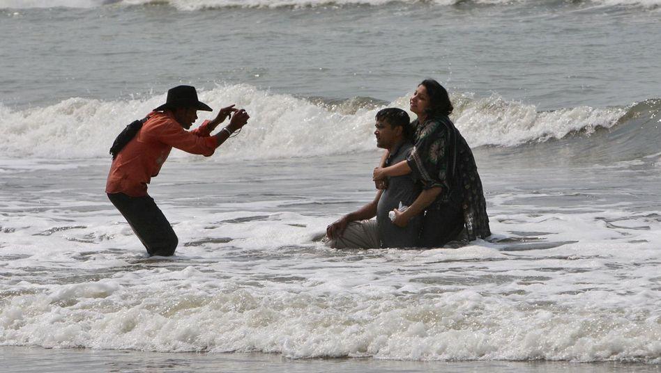 """Touristen am Golf von Bengalen (im März 2010): """"Von der globalen Erwärmung gelöst"""""""