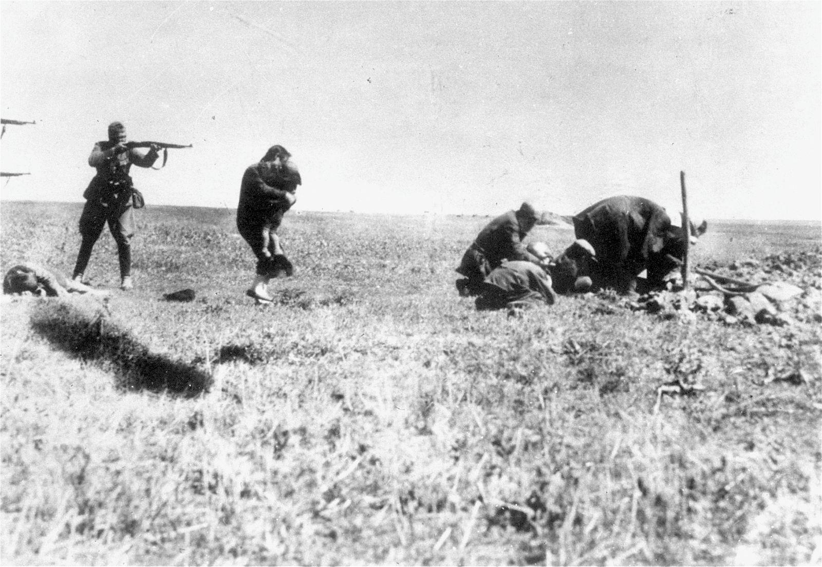 Execution of Kiev Jews Execution of Kiev Jews by German army killing units Einsatzgruppen = interve