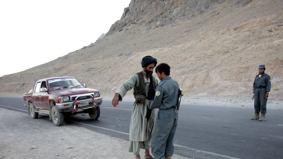 Scenes such as this one often end with the payment of a bribe in Afghanistan.
