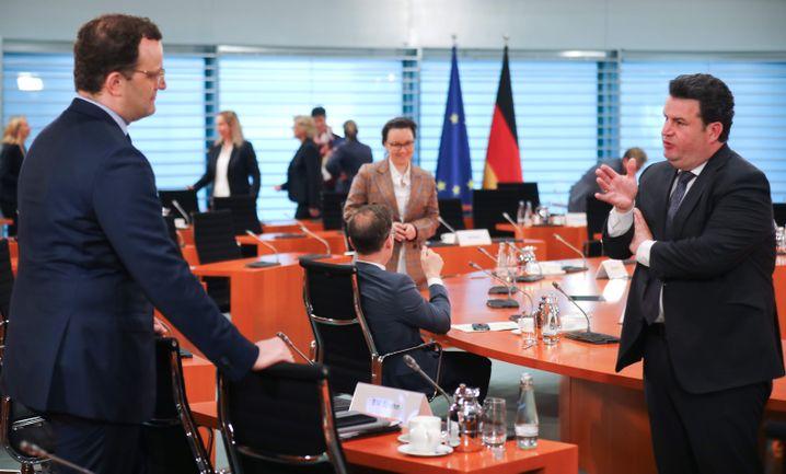 In der Sache vereint, im Wahlkampf getrennt: Gesundheitsminister Jens Spahn (l., CDU) und Arbeitsminister Hubertus Heil (SPD)