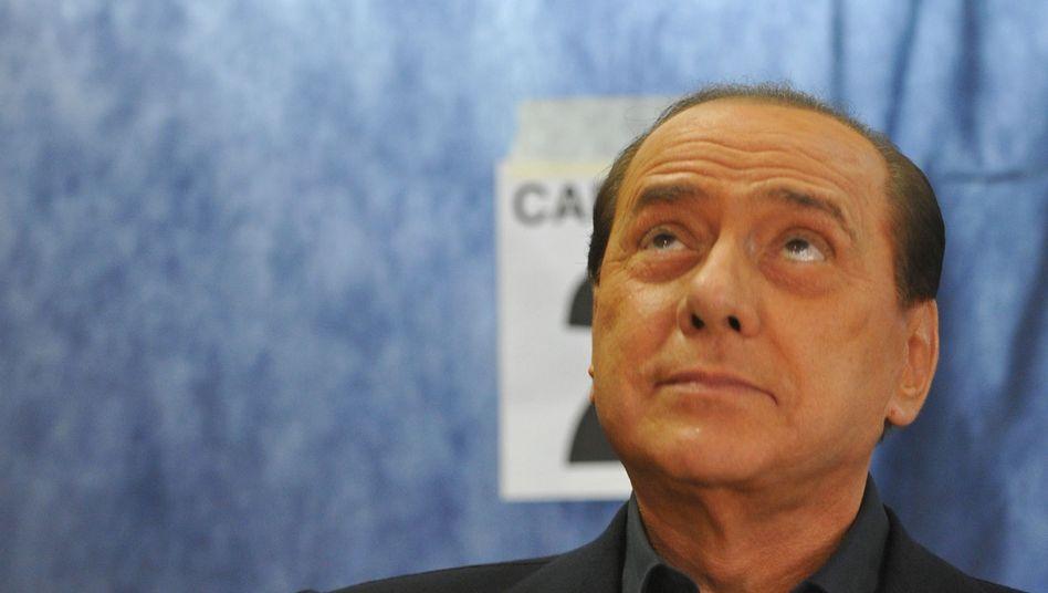 Italiens Ministerpräsident Berlusconi: Skandalfotos ließen die Wähler kalt