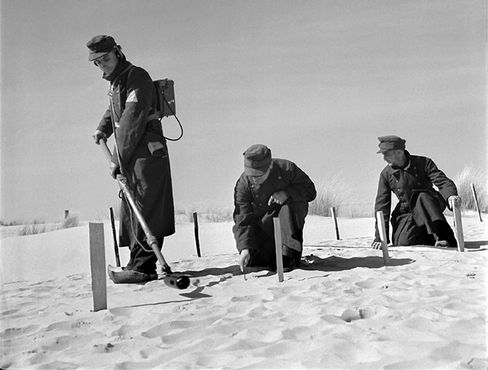 German prisoners of war being used as mine clearers in Dunes along the coast of France.