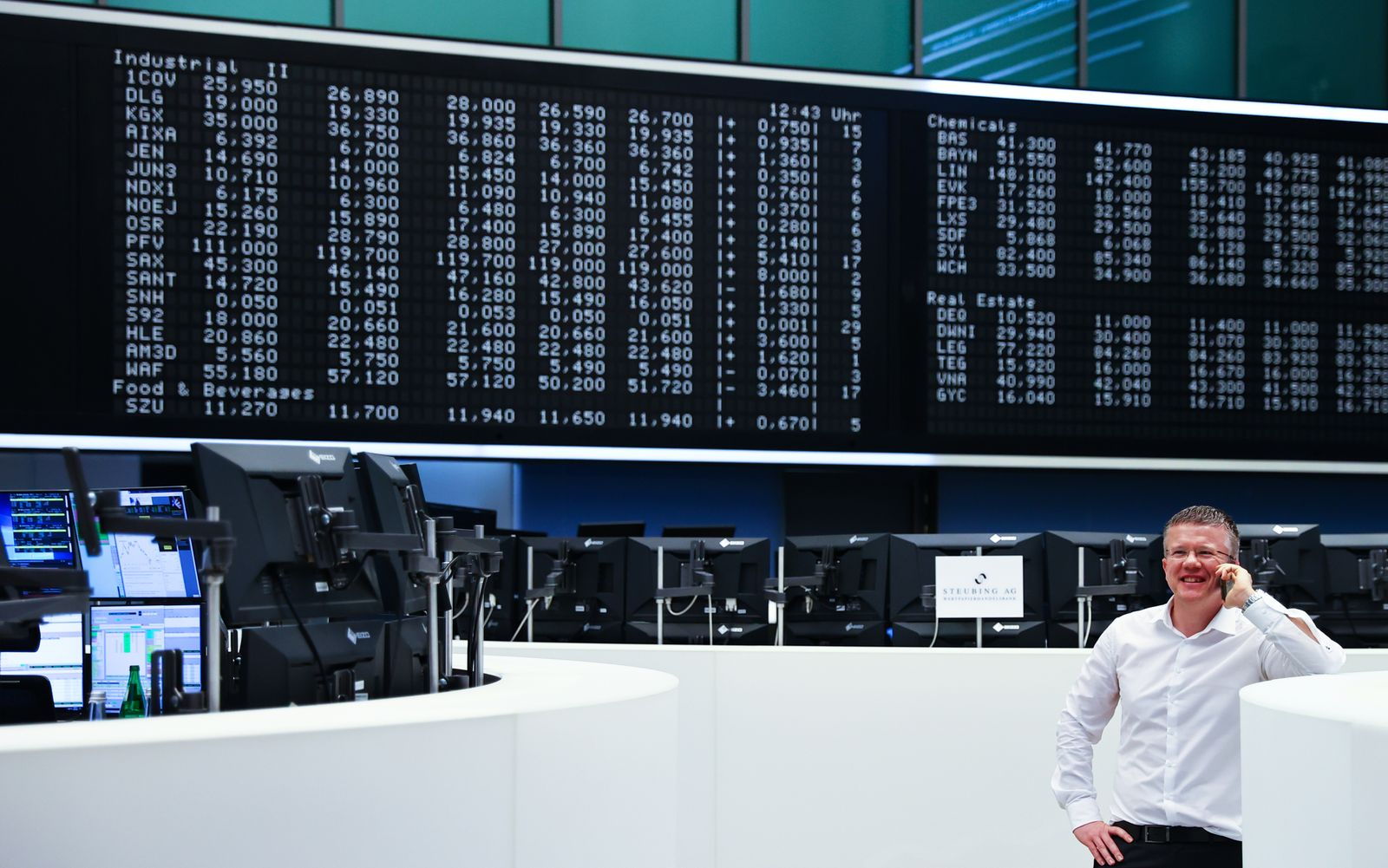 A stock trader uses his mobile at the stock exchange in Frankfurt