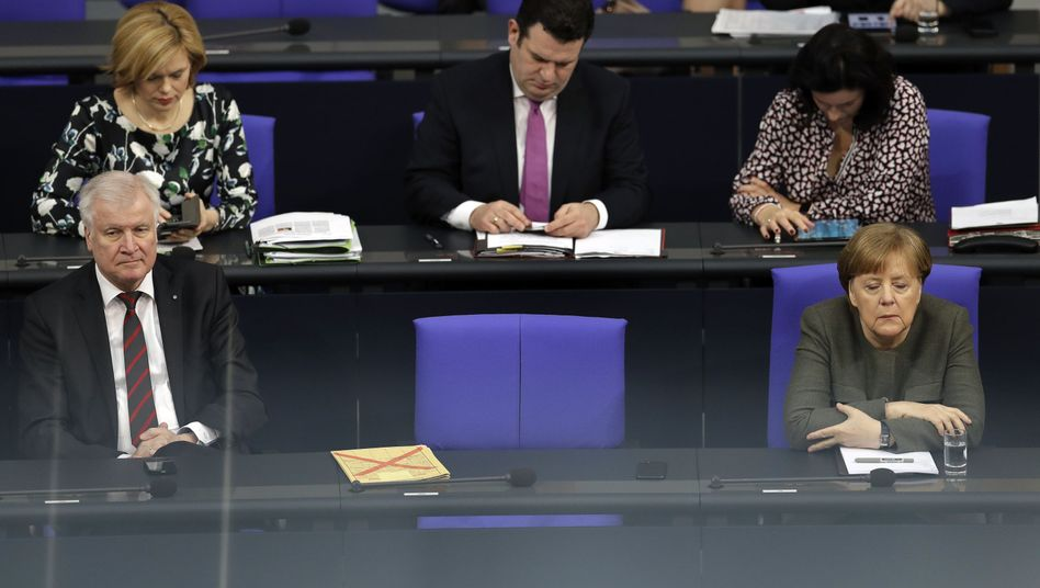 German Interior Minister Horst Seehofer and Chancellor Angela Merkel in parliament on Thursday.