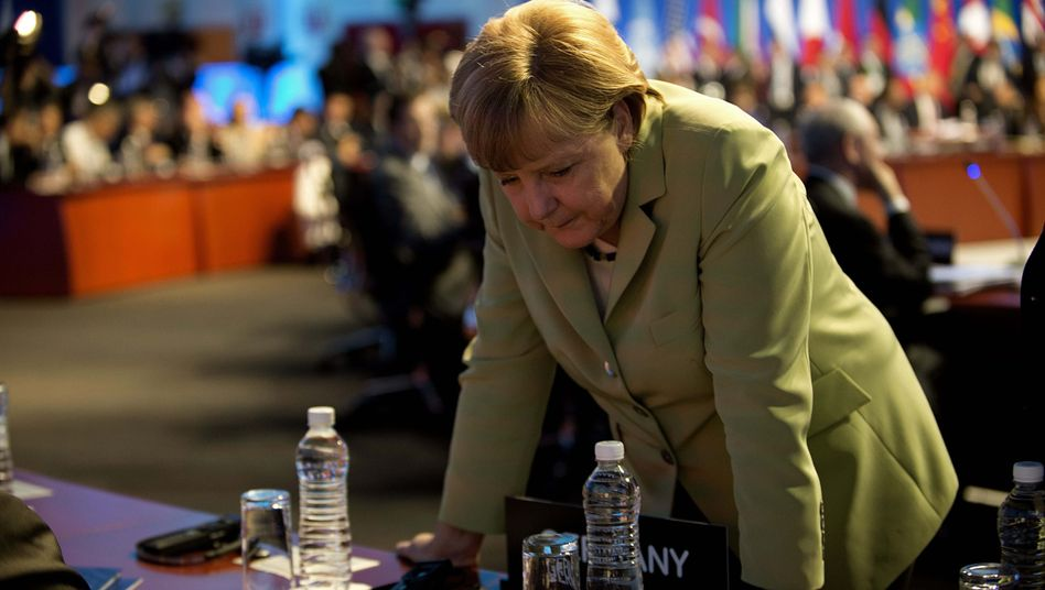 Chancellor Merkel is feeling the weight of the world economy on her shoulders.