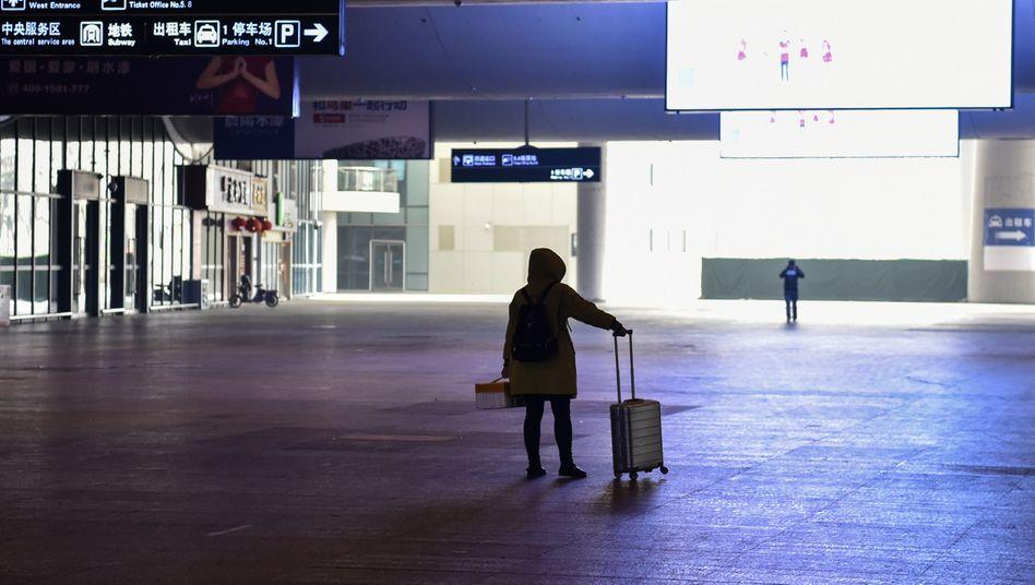 Reisende in Wuhan: Die Situation in der Stadt bleibt laut den Behörden ernst