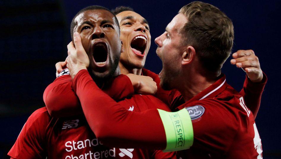 Liverpools Georginio Wijnaldum, Trent Alexander-Arnold und Jordan Henderson (v.l.) jubeln gegen Barcelona