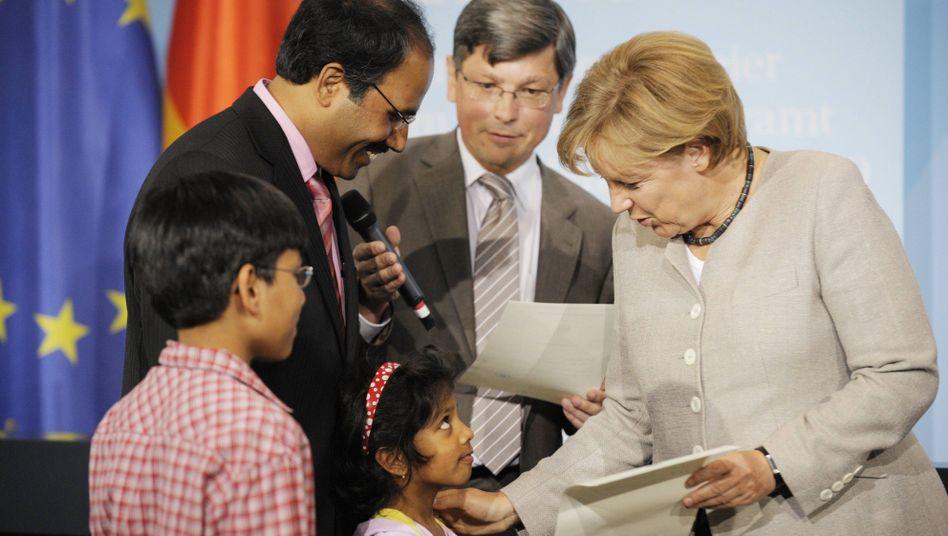 Kanzlerin Merkel (bei einer Einbürgerungsfeier 2009): Bekenntnis zur Leitkultur