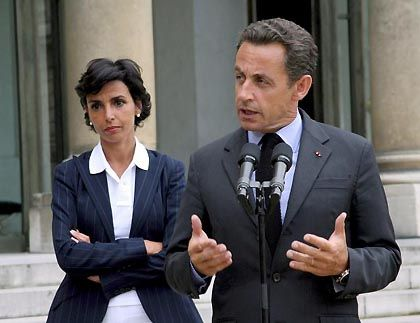 French Justice Minister Rachida Dati with President Sarkozy. The inclusion of a number of Muslim women in the cabinet has provided girls and women in the Muslim community with role models.