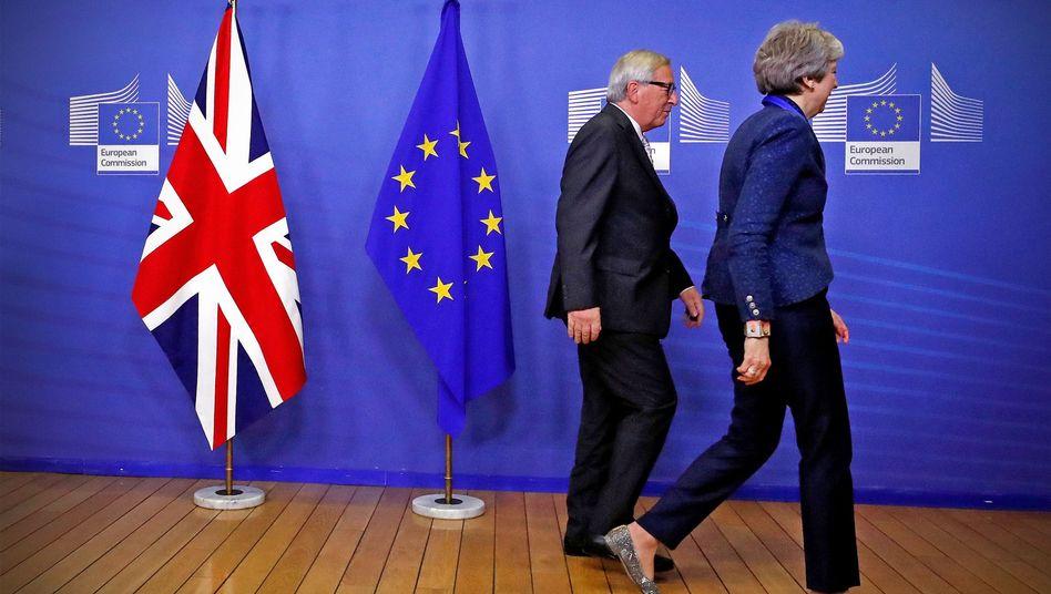 Jean-Claude Juncker und Theresa May