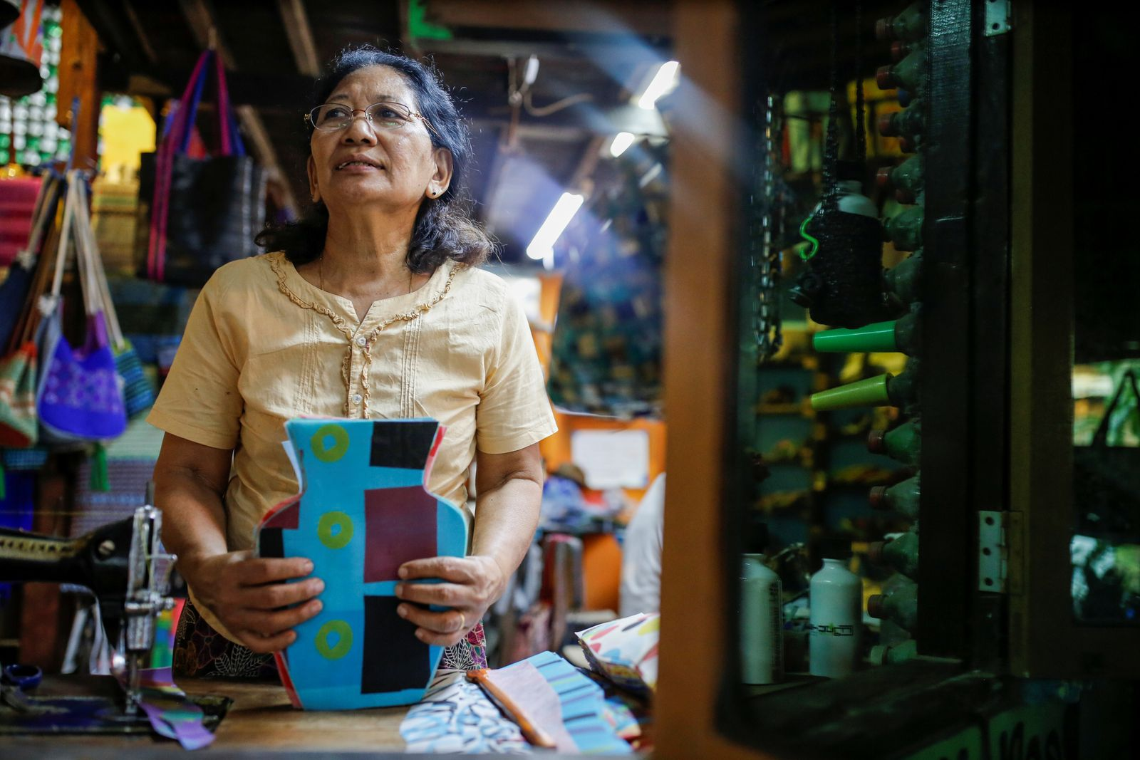Wendy takes a break from making recycled products at ChuChu house in Dalla township, Yangon