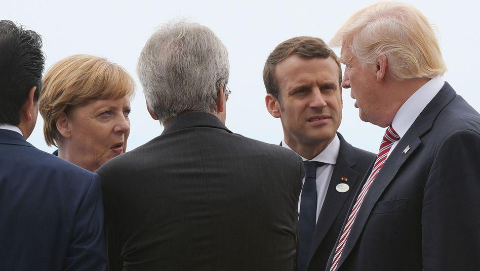 Angela Merkel, Emmanuel Macron, Donald Trump