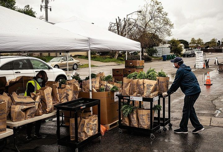 "Helpers at the food bank in Alameda, California: ""There are 10 times more people coming than usual."""