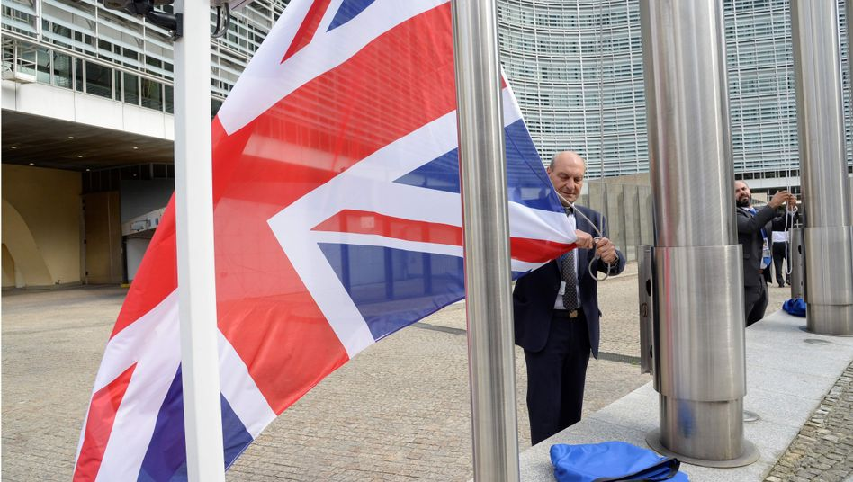 The British flag is removed at the end of a summit at the European Commission headquarters in Brussels.