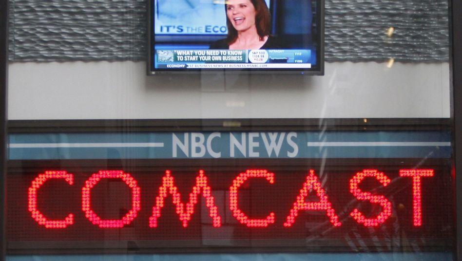 Comcast-Schriftzug in Nachrichtensendung