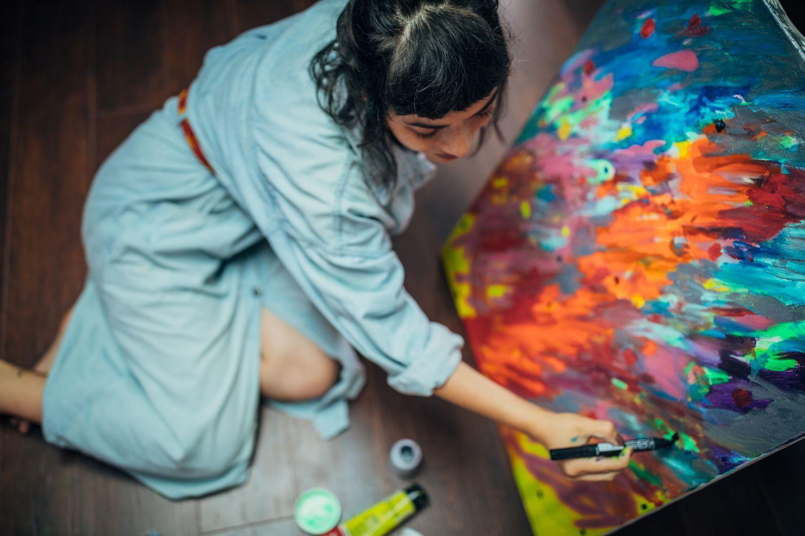 Creative woman painting in her studio