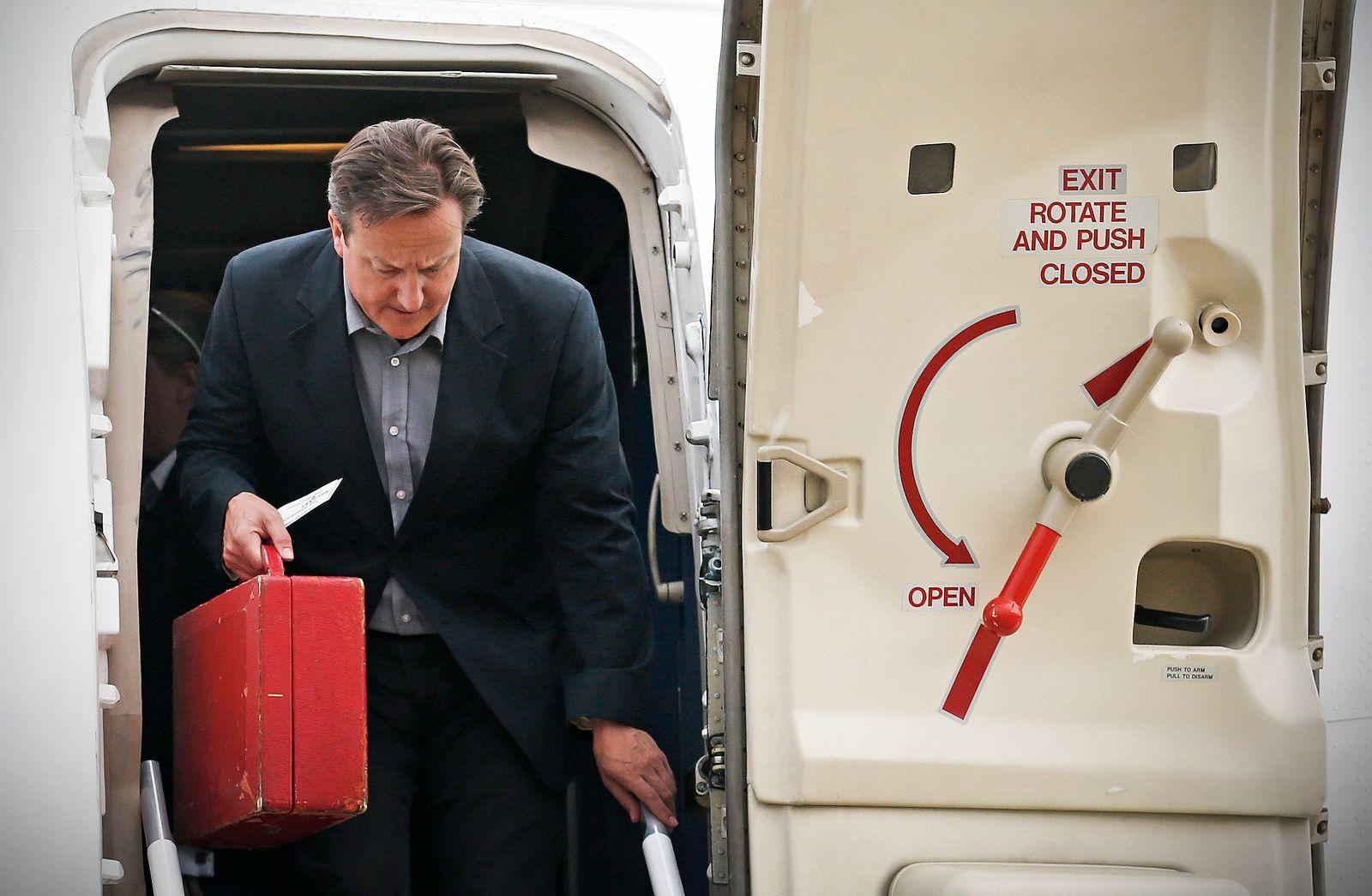 Britain's Prime Minister David Cameron arrives to attend the Enniskillen G8 summit at Belfast International Airport