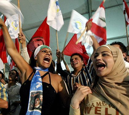 Lebanese government supporters celebrate after hearing that the UN Security Council voted to set up a tribunal into the murder of former PM Rafik Hariri.