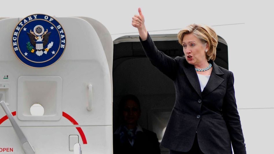 Thumbs up from US Secretary of State Hillary Clinton.