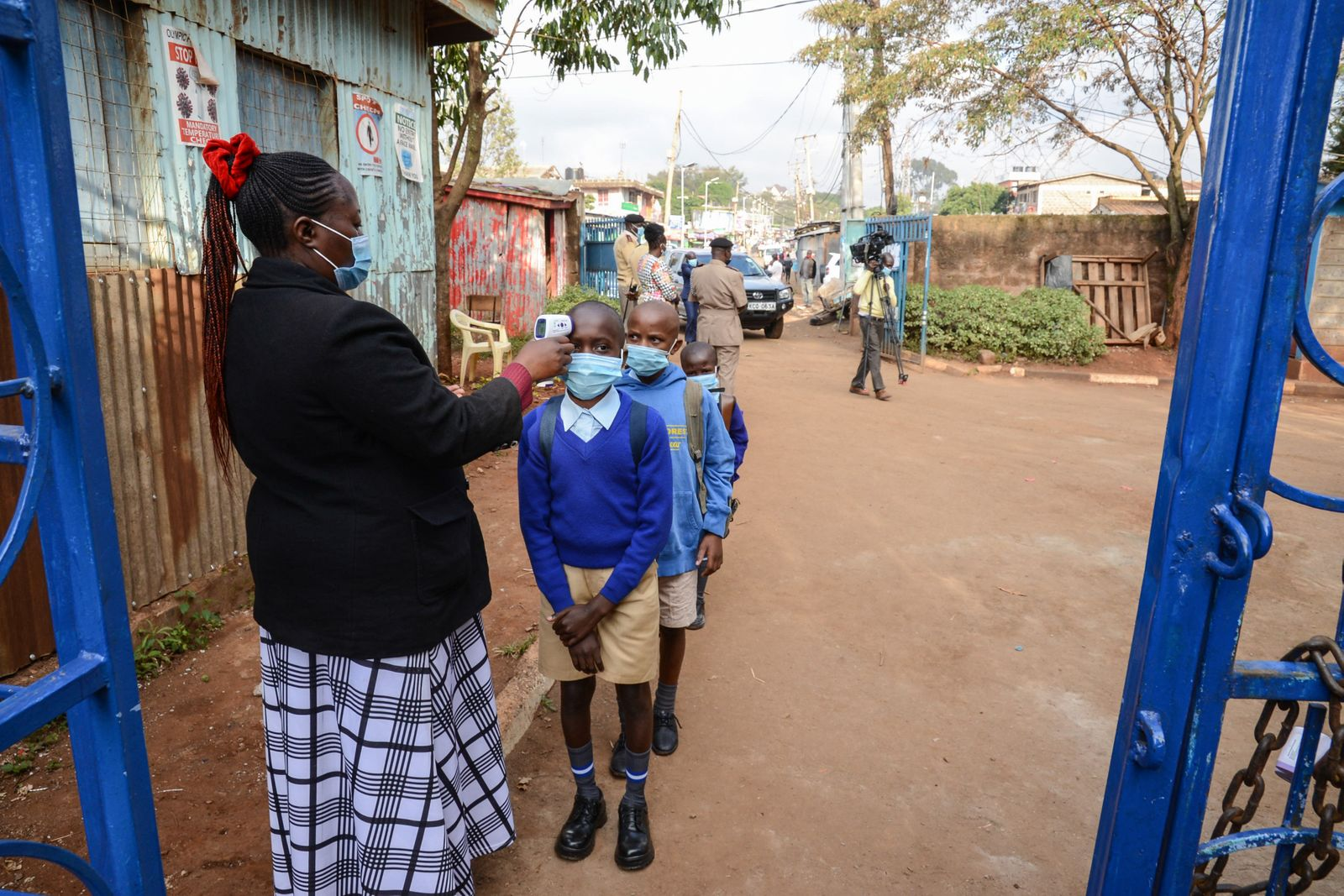 A teacher at Olympic Primary School wearing a facemask uses