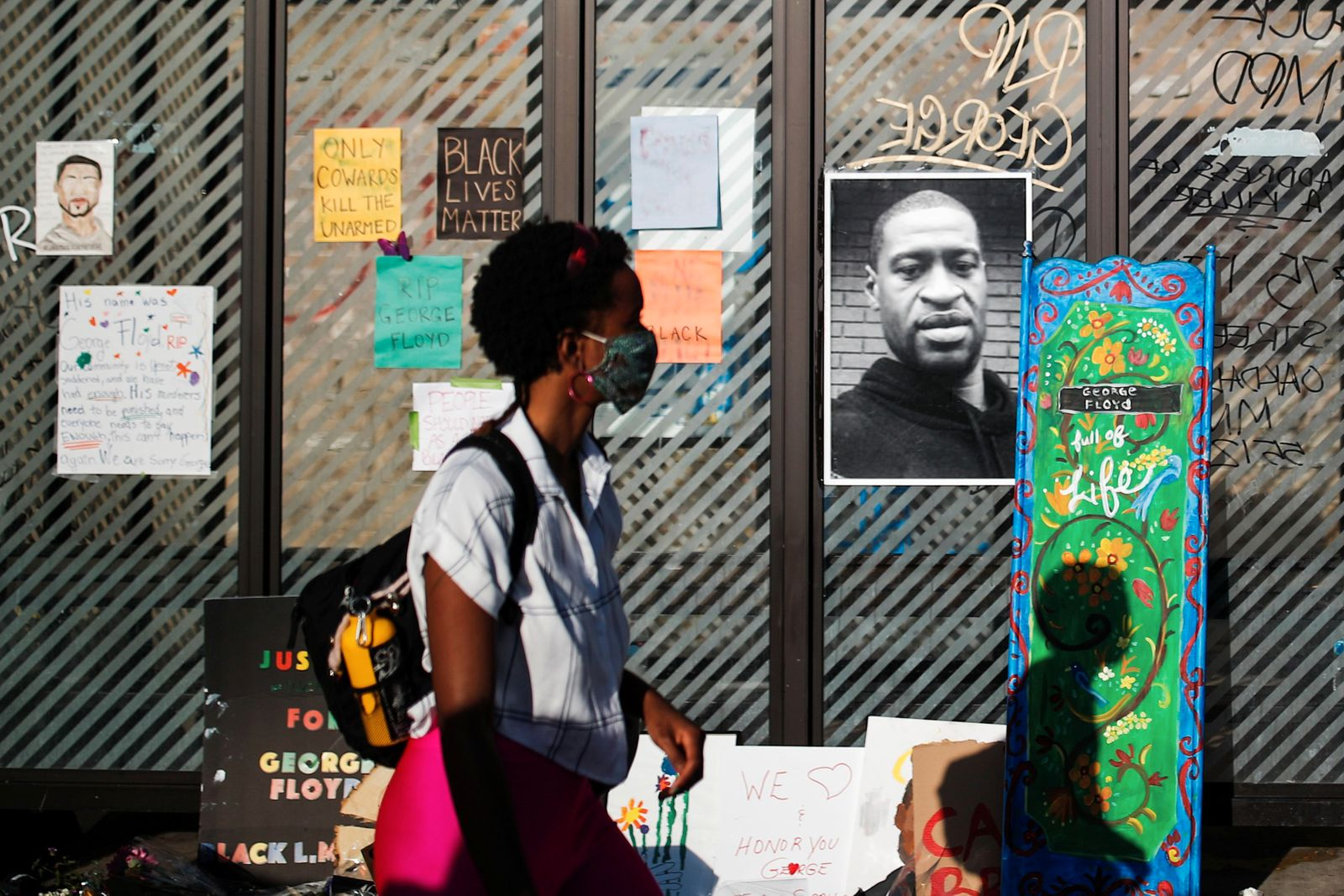 A picture of African-American man George Floyd is seen at a makeshift memorial put up by protesters at the corner where he got arrested in Minneapolis