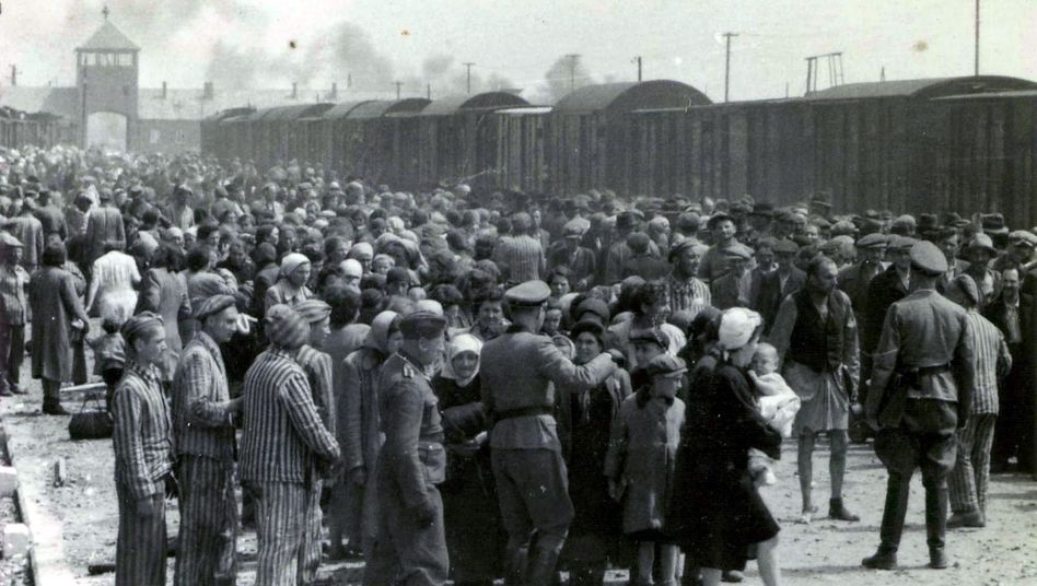 Photo dated May 27, 1944 showing Nazis selecting prisoners on the platform at the entrance of the Auschwitz-Birkenau extermination camp.